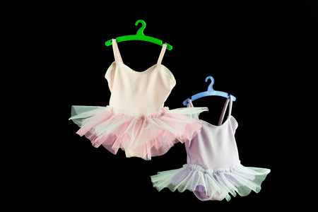 pink and lilac tutu for baby on black background Stock Photo