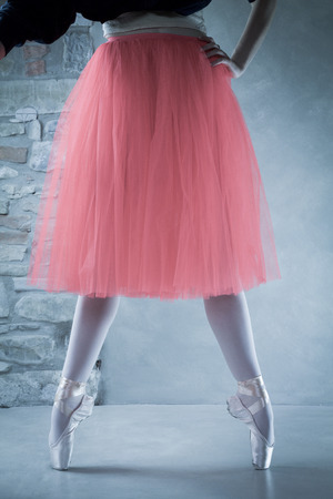 ballet dancer on pointes in second position with beautiful pink tutu