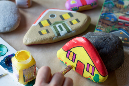 homemade stones painted as homes