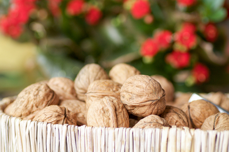 breackfast: group of walnuts in a basket, blurred background