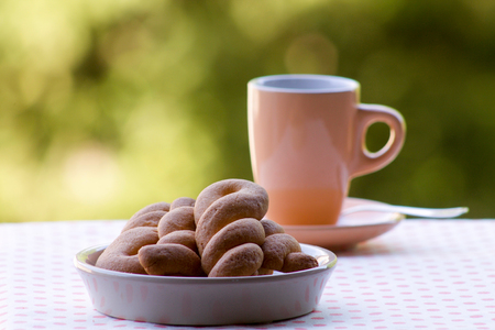 italian breakfast, coffee  with biscuits of pastry blurred background
