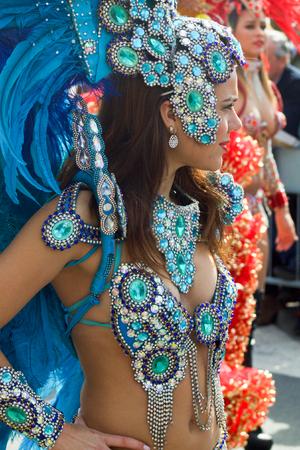 ITALY, SANREMO - MARCH 12, 2017 the spring parade, beautiful female street artis, brazilian dancer in multicolored costume Editorial