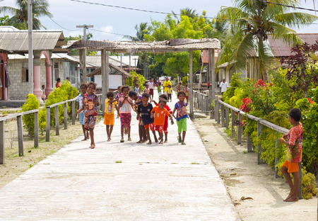 WEST PAPUA, RAJA AMPAT - August 28, 2017 :  group of unidentified asian indigenous children in a street of local village playing Editorial