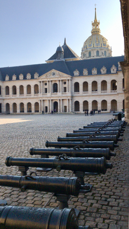 PARIS - FEBRUARY 24, 2018: group of cannons  in the central courtyard  of les invalides in Paris. The National Residence of the Invalids and Army Museum