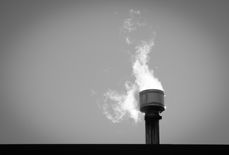 white smoke coming out from a metallic  chimney, copy space Stock Photo