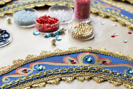 details of homemade blue folk russian tiara with paillettes and beads Stock Photo
