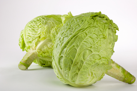 Close up of two fresh green cabbage with stem on white background Stock Photo