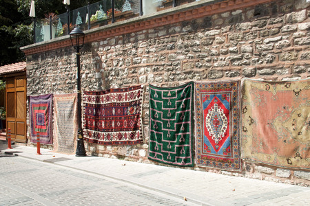 group of colorful carpets hanging on display in Istanbul street Stock Photo