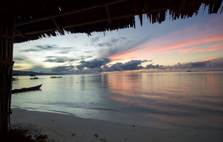 beautiful sunrise by the beach  in raja ampat archipelago, west papua