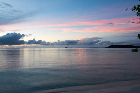 sky, sea and land in the magic moment after sunset, west papua