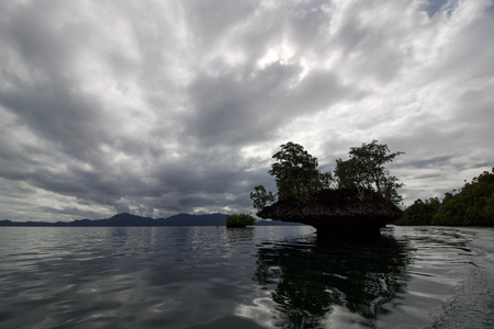 typical seascape in raja ampat archipelago with erosion of rocks, west papua