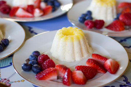 close up of fresh  lemon parfait, dessert decorated with barries