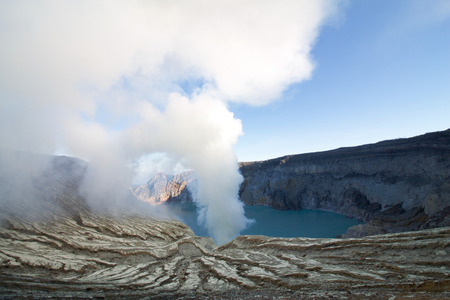 white smoke coming out from the Kawah Ijen volcano with active solfataras and a lake of sulfuric acid, Java island
