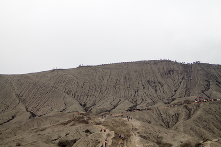 JAVA - Tengger semeru national park - August 29,2016: black sand on the wall of bromo volcano with the step for tourists to go to the top to see the active crater