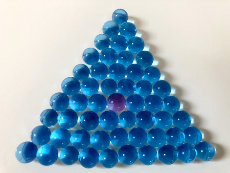 triangle geometric shape  made by a group of blue water beads