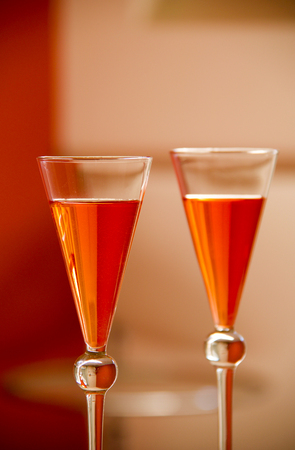 close up of two orange cocktails with beautiful glass reflections Stock Photo