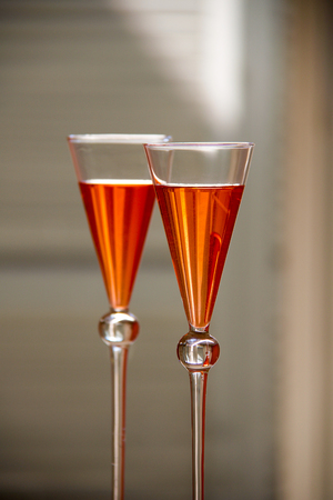 fresh orange cocktails in glasses with a conical shape