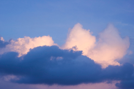 different colors of clouds in a blue sky