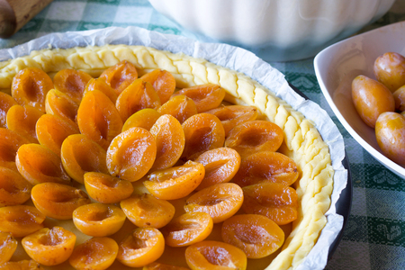 close up of short pastry with yellow plum decoration before baking Stock Photo