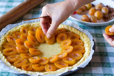 close up of  homemade yellow prune tart preparation