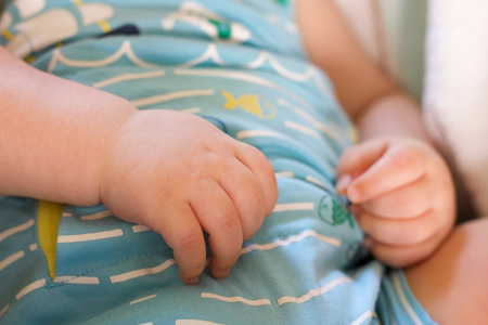 close up of baby boy hand selective focus sleeping relaxed