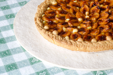 close up of part of plums tart with shortbread and fresh fruits, copy space