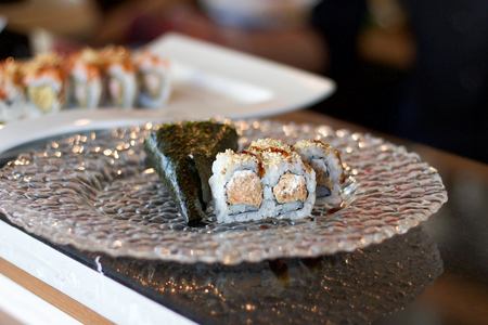 close up of sushi in a glass plate, bokeh background Stock Photo