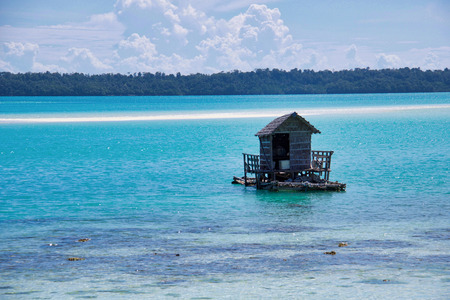 the fisherman house in the  beautiful turquoise celebes sea at low tide, indonesian borneo
