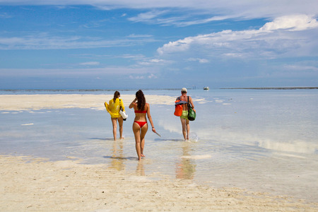 group of people walking towards the boat because of the low tide, indonesian borneo Stock Photo