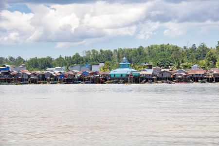 water village along a river in borneo island, Indonesia