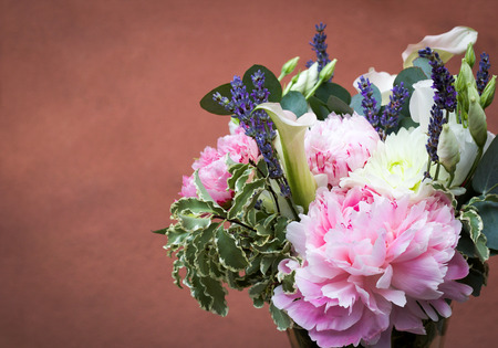 beautiful ornamental bouquet of spring flowers isolated on antique pink Stock Photo
