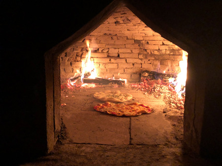 two italian pizza are cooked  in old wood oven Stock Photo