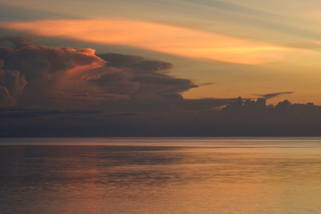 selective focus on beautiful shades of clouds in tropical sunset, peace concept