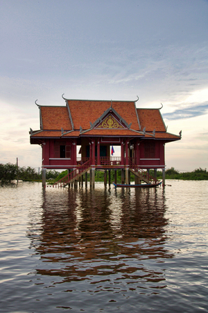 house on the water at sunset in the water village near Kampong plug and tonle sap lake, Cambodia