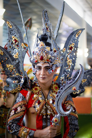 JAKARTA - September 5, 2018: portrait of handsome boy in gray south east asia  traditional cerimonial costume  and precious stones during a parade