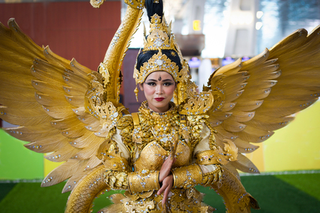 JAKARTA - September 5, 2018: portrait of beautiful woman in south east asia  traditional cerimonial costume with  gold and precious stones during a parade Editorial