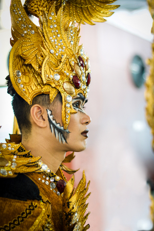 JAKARTA - September 5, 2018: head portrait of handsome boy in south east asia  traditional cerimonial costume with  gold and precious stones during a parade Editorial