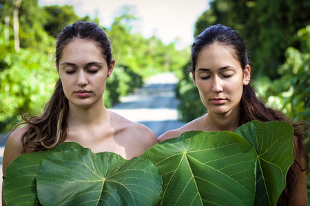 natural beauty in the nature, portrait of two nude girls covered by green leaves