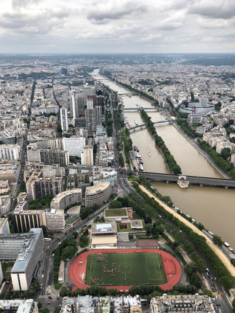 aerial view of the city of paris and seine river with its bridges from eiffel tower