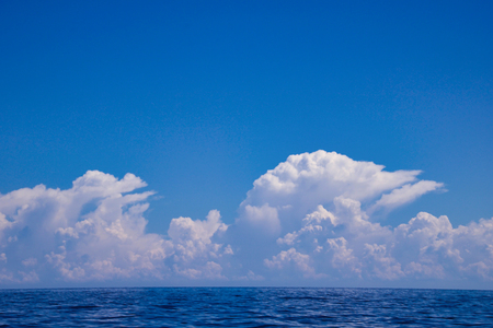 beautiful white clouds over the sea on a blue sky  in similar shape, kalimantan, borneo island Stock Photo