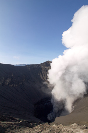 white smoke coming out of the bromo volcano  crater, java island