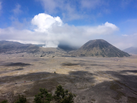 smoke  comes out  of the bromo volcano in java island, Indonesia Stock Photo