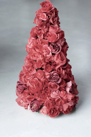 antique pink for paper roses that create unusual christmas  tree, gray background