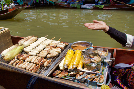 seller of fruits and vegetables in traditional floating market in bangkok, thailand Stock Photo