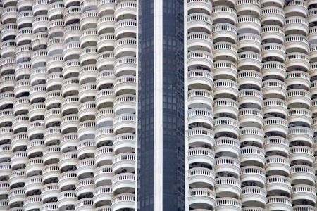 full frame photograph looking at the exterior facades of a city skyscraper, thailand Stock Photo