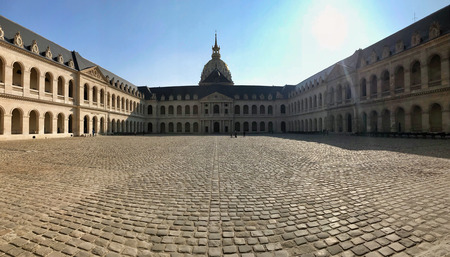 PARIS - FEBRUARY 24, 2018: the central courtyard  of les invalides in Paris. The National Residence of the Invalids and Army Museum with dome des invalides containing Napoleon tomb Sajtókép