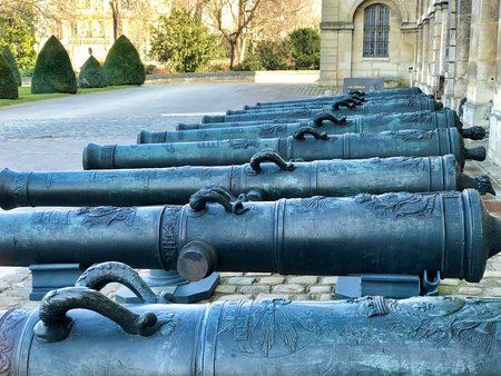 PARIS - FEBRUARY 24, 2018: group of cannons  in the entrance courtyard  of les invalides in Paris. The National Residence of the Invalids and Army Museum Sajtókép