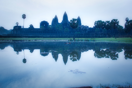 mystical atmosphere at sunrise at Angkor Wat buddhist temple in Cambodia