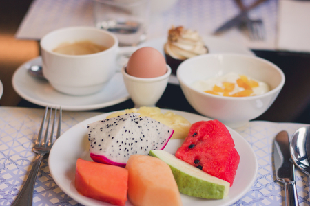 healthy breackfast with variation of  fruits egg and coffee