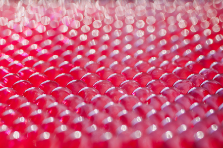 soft focus on a group of lined hydrogel balls in fuchsia color Imagens